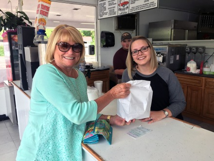Connie Bruner stops in and picks up an order from Hayley Peake at The Patio on Tuesday, May 9, 2017.